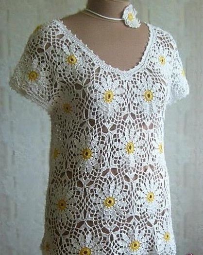 Hello!!! Look at this charming blouse and a free crochet with these details in bloom ... and the point is very beautiful !!!!. Very...