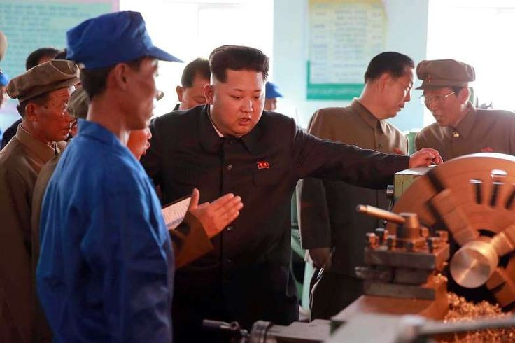 This undated photo released by North Korea's official Korean Central News Agency (KCNA) on Sept. 5, 2015, shows North Korean leader Kim Jong Un, center, at the Sinuiju Measuring Instrument Factory in North Pyongan Province.