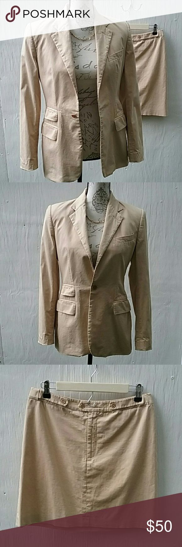 """Ralph Lauren blue label khaki suit. VG condition. Wear this slightly wrinkled, as shown, for a confident  dressed-down look. This suit was worn only a few times, but it had a few perspiration spots. I machine-washed it, like the tag says. It is a little wrinkled, but nowadays anything goes. It still looks very expensive.  Price reflects condition.  The size 6 jacket has a 37 inch bust. The hips are kinda  small, as shown. This suit does not run big.  The size 8 skirt has a 30"""" waist and is…"""