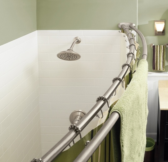 Double curved curtain rod – gives more space in the shower, plus holds towels.