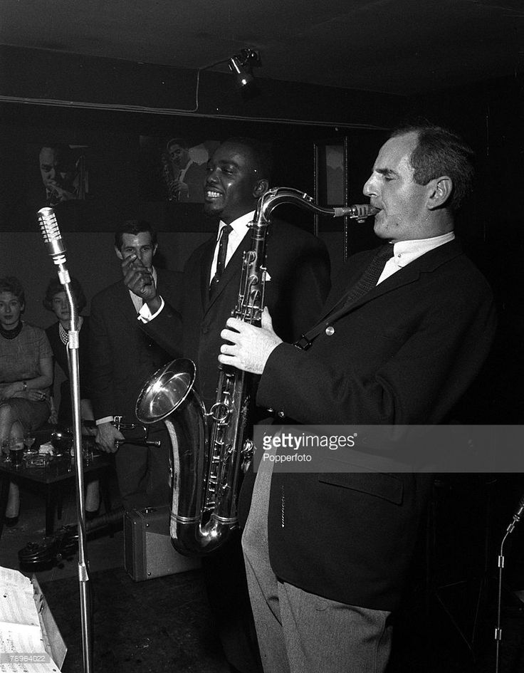 Gala opening of the Ronnie Scott Club, 1961. Jazz musician Ronnie Scott is pictured playing the saxophone.