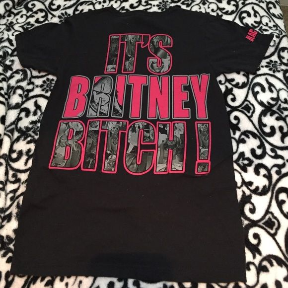 """Vintage Britney Spears tour t-shirt Vintage Britney Spears tour Tshirt. """"It's Britney bitch"""" is the design on the back. It's a size small. Very little stretch to it. Would fit S or XS more loosely. 100% cotton but no shrinkage because it's only been worn a few times and I hang dry my clothes. Tops Tees - Short Sleeve"""