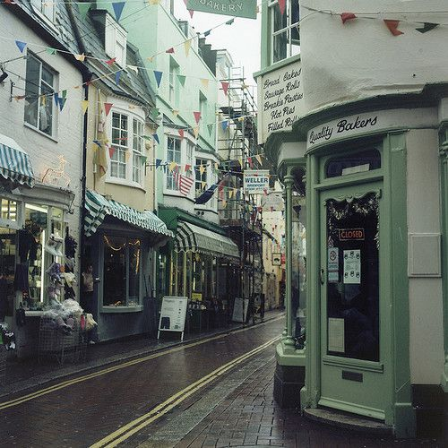 enchantedengland: This festive, charming little street is in the seaside town of Weymouth, Dorset, which sits on a sheltered bay of the River Wey on the English Channel coast.