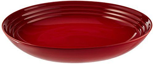 Le Creuset Dinnerware Le Creuset dinnerware pieces are a vibrant expression of color and character. These stoneware pieces features Le Creuset's legendary raised rings and a perfectly matched pallete of signature shades.  Each piece of Le Creuset dinnerware is crafted in the same careful... - http://kitchen-dining.bestselleroutlet.net/product-review-for-le-creuset-stoneware-9-34-inch-pasta-bowl-cerise-cherry-red/
