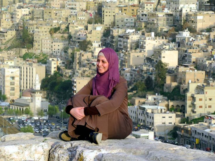 A woman poses on the ramparts of the Citadel in central Amman, Jordan.