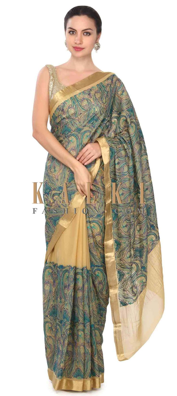 Buy this Mustard saree featuring in resham embroidery in paisley motif only on Kalki