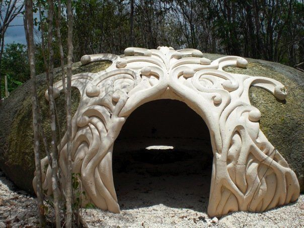 cob house doorway - looks like a fairy house in a river pebble