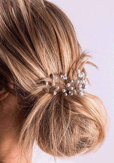 A personal favorite from my Etsy shop https://www.etsy.com/listing/468459999/silver-pearl-crystal-hair-vine