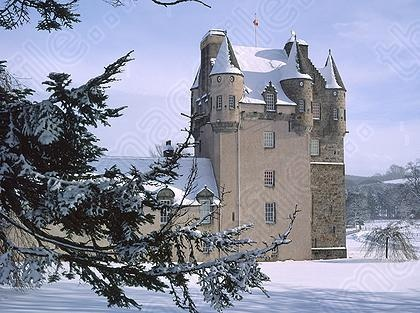 Image of Castle Fraser Snow Winter Side Tower Turrets Donside Mar Aberdeenshire Scotland dates from between 1575 and 1636 | Jim Henderson