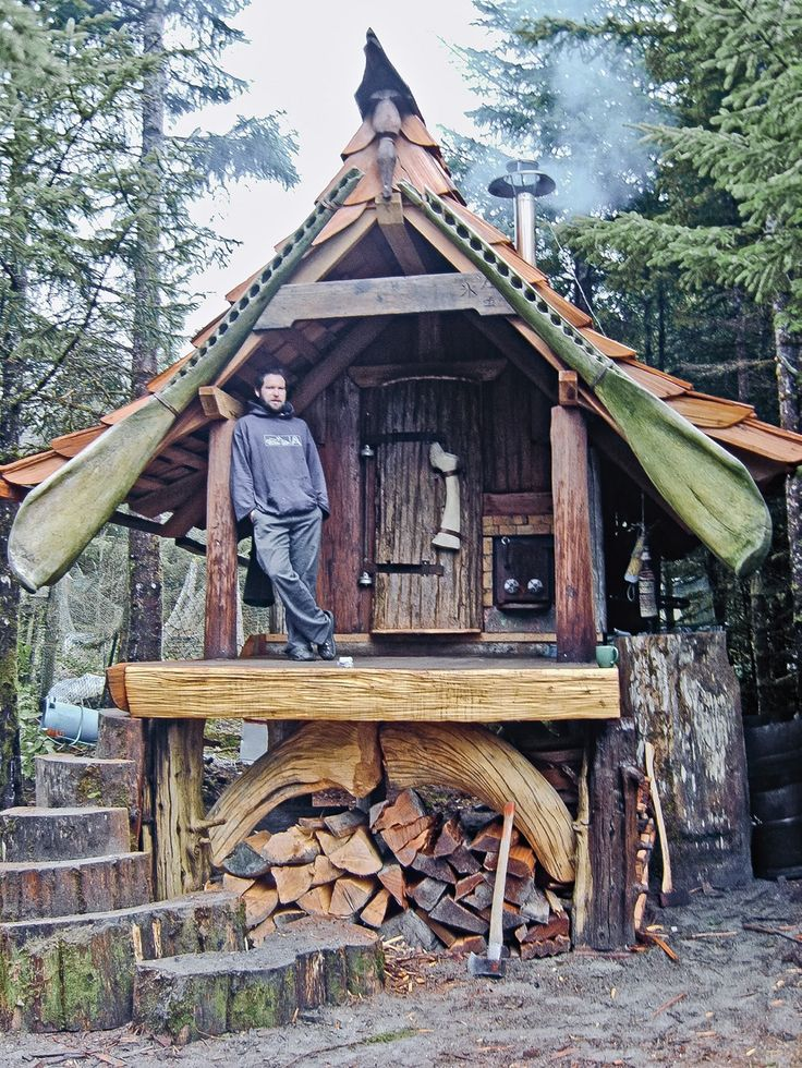 Sauna in Queen Charlotte Islands by Colin Doane. Lashed to front rafters are green whale jawbones. [From p. 133 of Tiny Homes by Lloyd Kahn]