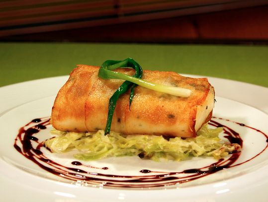 Potato wrapped Halibut or Chilean Seabass wilted leaks and balsamic glaze