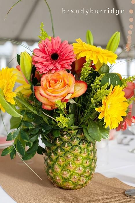 Tropical Wedding. Party Planning Connection Pineapple Floral Arrangement - Great idea for Hawaiian, pool or beach party. www.theenglishroom.biz