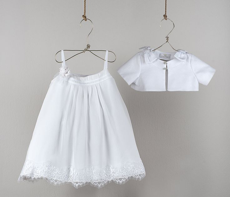 White shoulder strap dress with silk crepe pleated muslin, French Chantilly lace style at edge and handmade roses in silk crepe  White cotton piqué bolero with decorative bows on the shoulders and rhinestone buttons