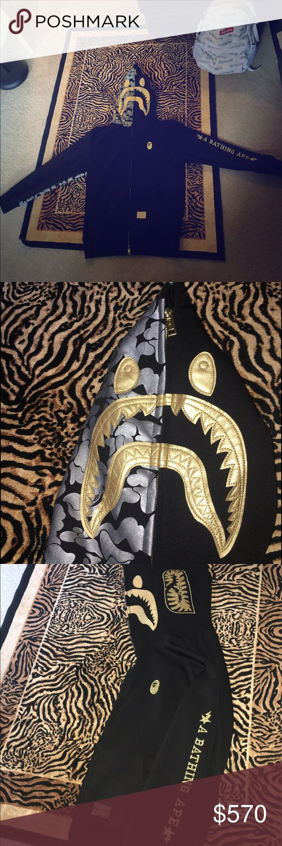 Bape Black collection Shark Hoodie (RARE) Size is an XXL but fits like L Jacket is in very good condition and has only been dry cleaned. This jacket is rare and from the bape black collection. Bape black is suppose to be a more luxurious and expensive bape for this reason the material is different. Travis scot has been seen wearing this hoodie as well. Purchased from Japan a few year ago but hardly worn and kept in very good condition ! I am selling for such a cheap price because I owe money…