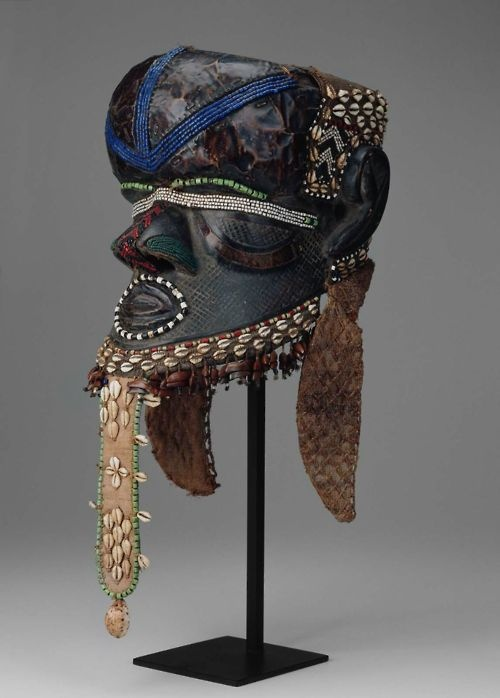 Africa | Kuba Mask.  This bold helmet mask was used at initiations and other ceremonies related to the founding of the Kuba kingdom and its ruling Bushoong family.