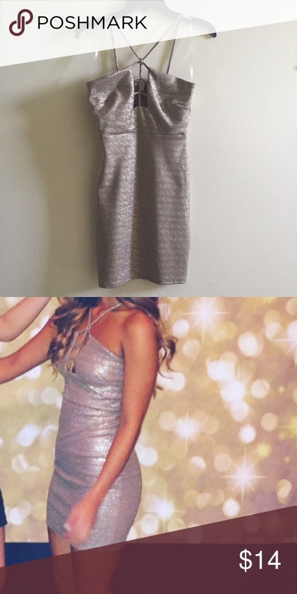 Gold sparkly body con sexy cut out dress beautiful body con dress- perfect for a girls night out! worn once- no flaws. stretchy and super flattering on your curves Charlotte Russe Dresses Mini