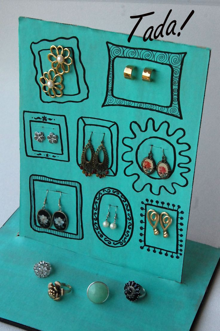 old cardboard made into earring display - blah to TADA!: An Array of Earrings