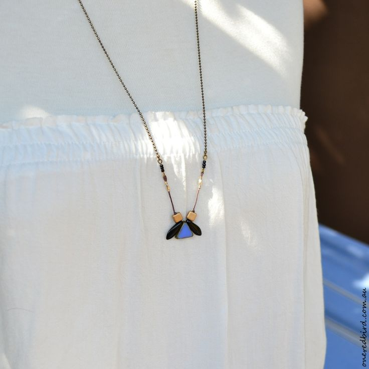 Sabi necklace ~ beautiful Czech glass and sterling silver on wire wrapped cord ~ sits below sternum ~ blue, black and gold glass necklace