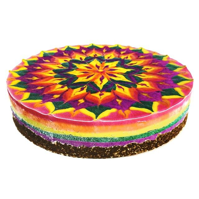 """""""Rainbow Lemon #rawvegancheesecake! Layers of color made by nature: blueberry, spirulina, turmeric, and beet.  All organic and tuned in to the sparkling…"""""""