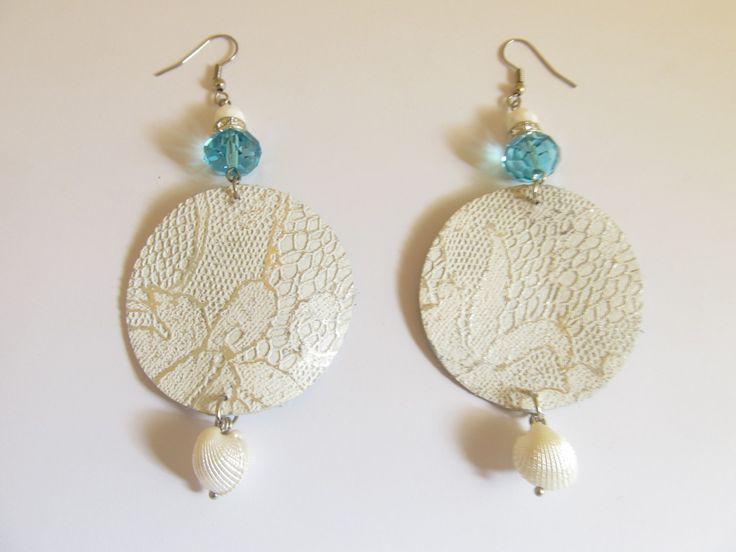 Handmade leather earrings (1 pair)  Made with white/silver embossed leather, metal rondell with crystals, glass beads and plastic white shell.