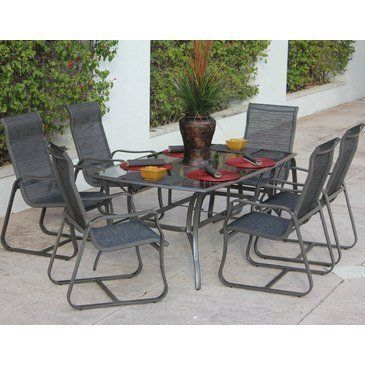Minorca 7 Piece Patio Dining Set with Glass Dining Table by Bellini Home and Gardens. $1536.60. Hand-applied textured finish. Includes 6 dining chairs and 1 Glass dining table. Pewter (PWT)/ Alexis (B1099). All-weather outdoor sling fabric in neutral shade. Belongs to Minorca Collection. What is included:Glass Dining Table (1)Dining Chair (6) The Minorca Collection, outdoor Dining Set for hosting a large family meal, with room for everyone at the spacious table...
