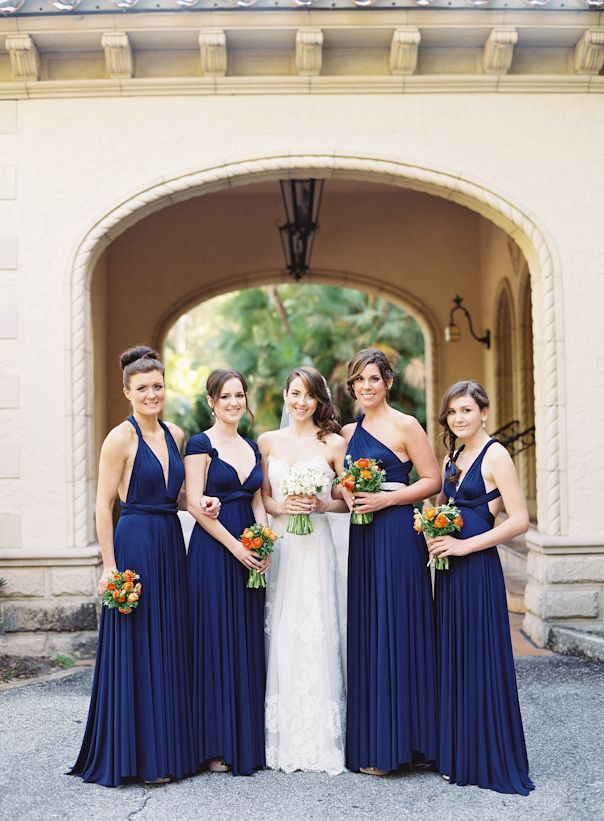 maids in navy two birds long dresses Love these dresses. And how they fit each maid. Love the one shoulder and the dress at the far left