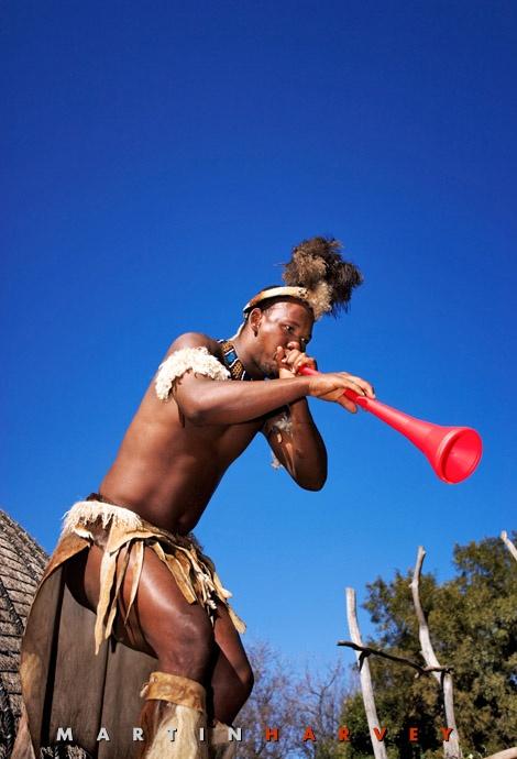 Zulu man blowing a vuvuzela. #SouthAfrica Martin Harvey Photography.