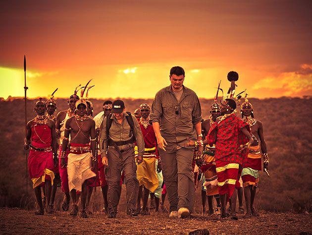 Yao walks with Samburu warriors in Kenya. (Photo by Kristian Schmidt for WildAid, via yaomingblog.com)