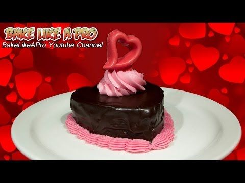 Mini Chocolate Valentine's Cake With Dark Chocolate Ganache, whipped cream buttercream frosting and chocolate red heart  I'll show you how to make the whole cake in easy to follow steps, we'll cover it with our dark chocolate ganache, and then pipe a rosette on top with our whipped cream buttercream frosting, then we'll put top it off with our cute chocolate heart that I created using Wilton's candy melt mold