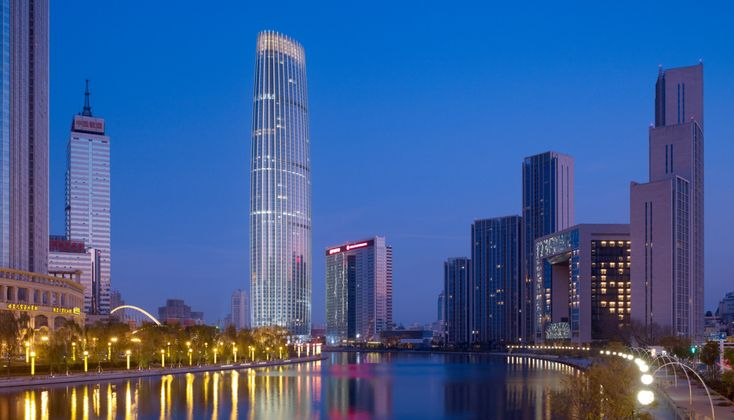 Tianjin Global Financial Center, located in the historic heart of Tianjin, embodies the city's international prominence as a physical and cultural gateway to China. Across the Hai River from Tianjin's high-speed rail and transit hub, the 337-meter