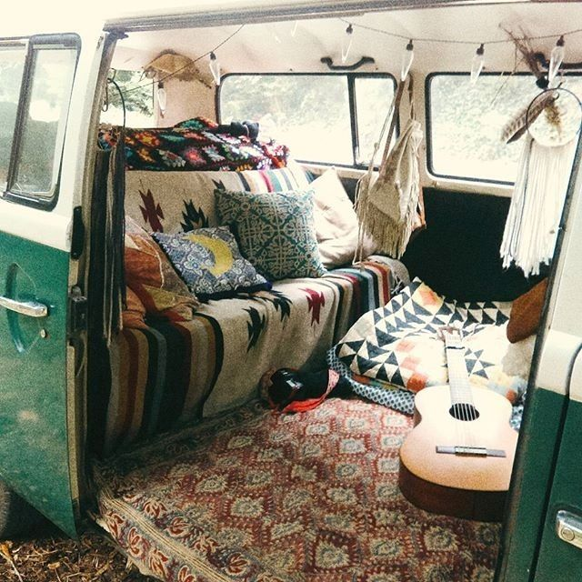 Furnished VW bus volkeswagen bus with geometric Aztec blankets acoustic guitar and bohemian Bohemia fashion style interior feuding