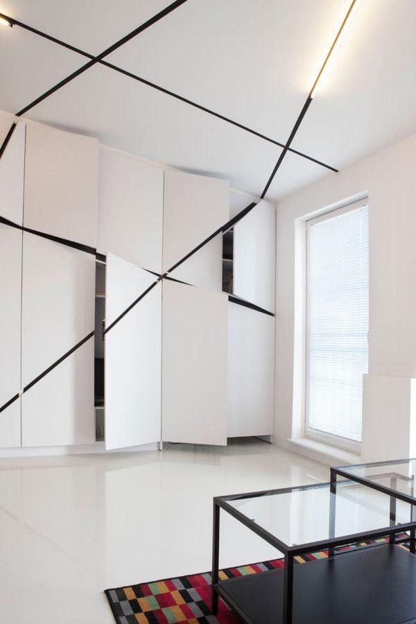 built-ins hide the TV, storage, and a desk // Peters Flat, designed by Mili Młodzi Ludzie in Łazarz, Poznań, Poland.