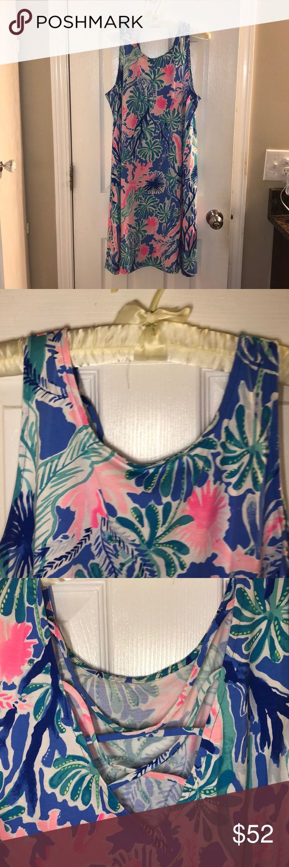 Lilly Pulitzer sleeveless dress Lilly Pulitzer summer dress in excellent condition! I am only selling because I recently had a breast reduction and it doesn't fit me around the chest anymore. This is a perfect, easy dress for the summer! Crisscross back Lilly Pulitzer Dresses