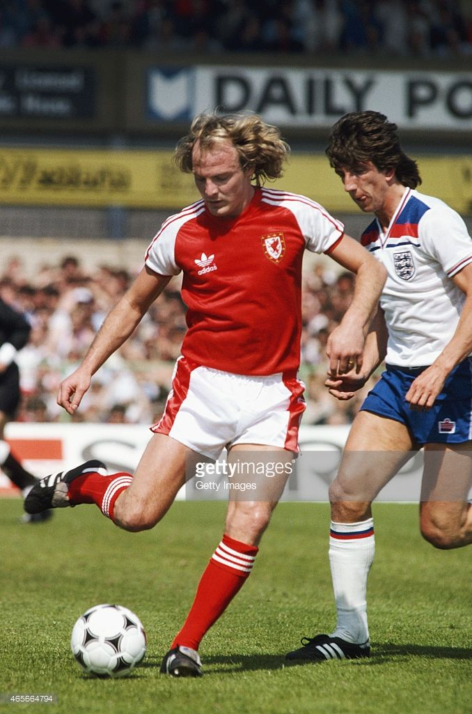 Wales player Terry Yorath holds off the challenge of England striker Paul Mariner during the 1980...