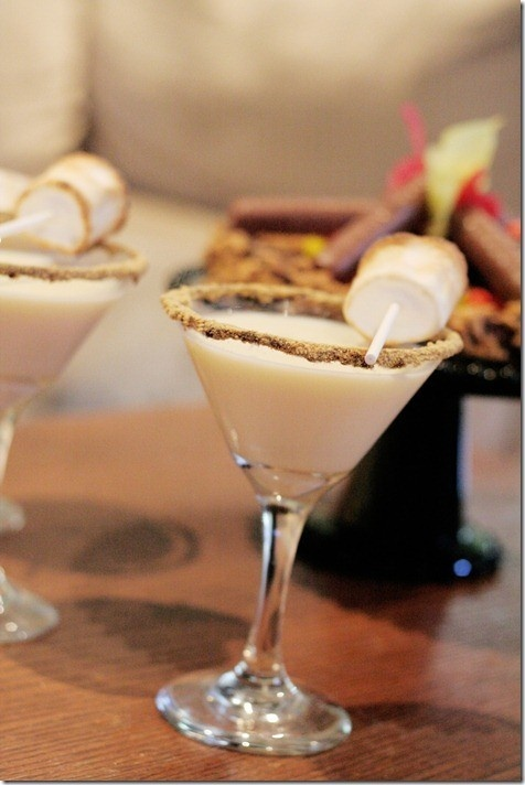 Smores Martini: 2 ounces chocolate flavored vodka 2 ounces white chocolate liqueur Rim glass with marshmallow creme. Coat with chocolate cocoa powder and crushed graham crackers. Drizzle chocolate syrup in glass. Combine liquor in shaker, shake with ice and strain into glass. Add marshmallow dipped in chocolate & graham crackers on skewer as garnish.