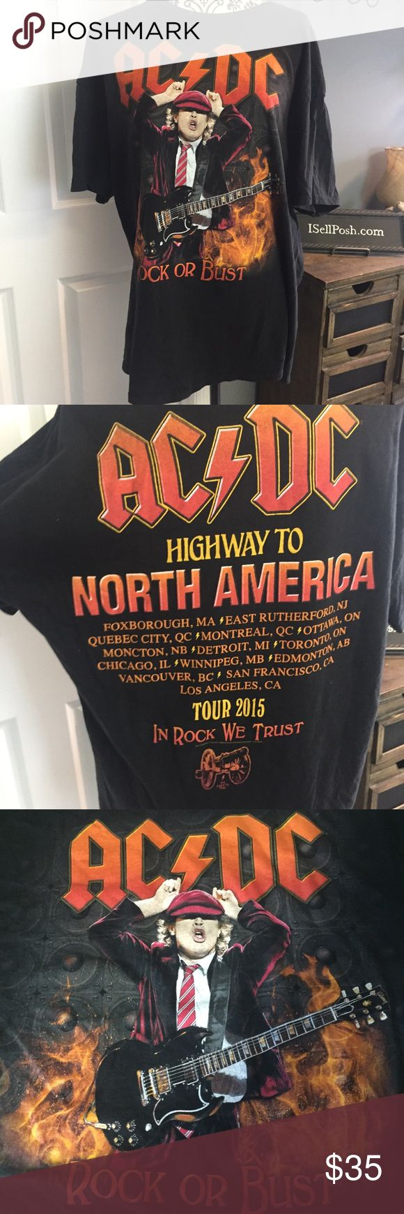 """AC DC Rock or Bust tour band concert T-shirt AC/DC Concert T-shirt. Original tour merchandise. Black short sleeve T-shirt. Laying flat, armpit to armpit is 22"""" and length is 29"""". Tag says adult XL. Unisex tee. AC/DC Shirts Tees - Short Sleeve"""