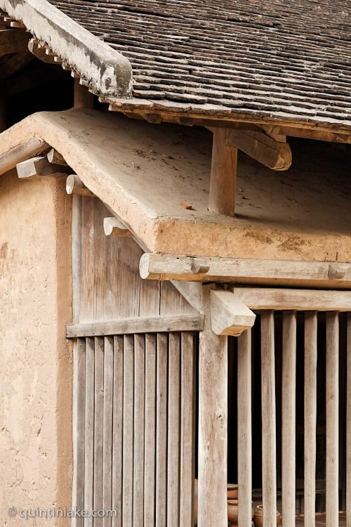 Double roof of Cham House for natural cooling in intense sunlight, Vietnamese Museum of Ethnology, Hanoi.
