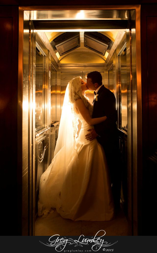 Stunnilngly creative elevator shot of bride and groom kissing