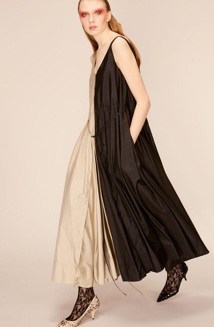 split dark chocolate and light beige easy flowing sleeveless dress by  Nina Ricci Resort 2018 collection.