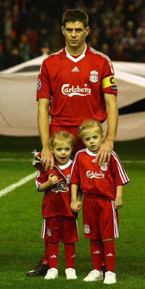 Steven Gerrard of Liverpool stands with his children Lilly-Ella and Lexie prior to the UEFA Champions League Group E match between Liverpool and Fiorentina at Anfield on December 9, 2009 in Liverpool, England.