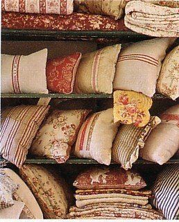 Vintage pillows add so much character to a room.  I must find more.