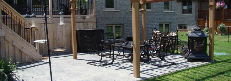 Stamped dark grey concrete patio. Great for entertaining.