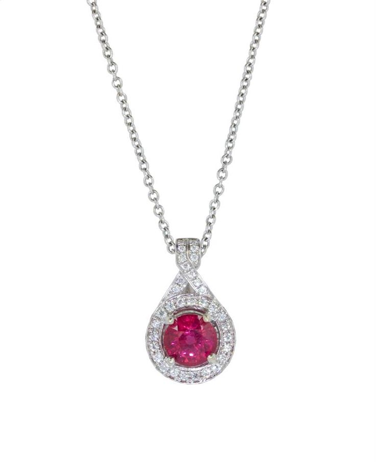 This 18k White gold pendant features a 1.08ct round ruby. 51 diamonds surround the ruby with a total carat weight of 0.25cts. Can't you picture this sparkler around her neck? www.gembycarati.com  www.facebook.com/gembycarati