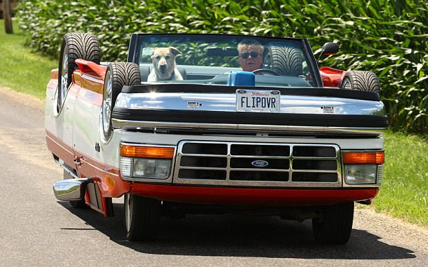 Rick Sullivan drives his upside down truck with his dog Murray in Clinton, Illinois. Rick spent six months and $6,000 building the topsy-turvy truck from the parts of two separate vehicles.The road-legal car is created from a 1991 Ford Ranger pickup truck with a 1995 F-150 pickup truck body placed over the top - upside down.