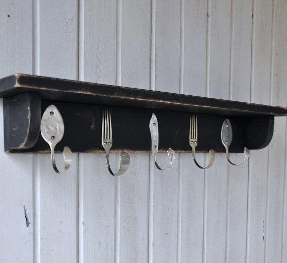 $65 Coat rack made with silverware. LOVE it with a family photo leaning on top in an entrance way.