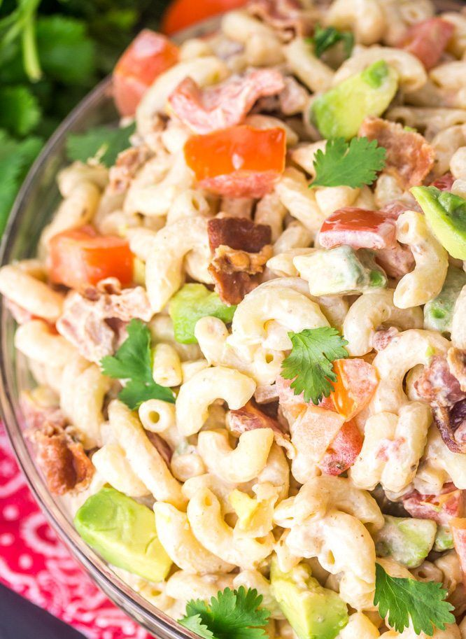 Southwest Tomato Bacon Pasta Salad. We used a special ingredient which is NOT mayonnaise.  Packed with tomatoes, avocados, cilantro and BACON!