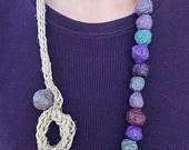 Necklace of colored paper pulp beads
