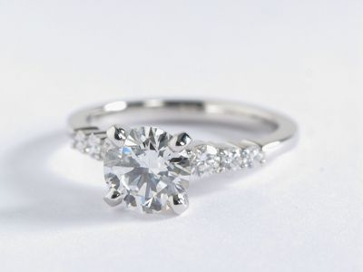 1.2 Carat Diamond Engagement Ring | Capture your lasting love with this delicate platinum engagement ring, showcasing pavé-set round diamonds along the shank and your choice of center diamond.