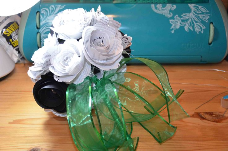 Black and white paper flower bouquet with green ribbon wrap.  Available from AJ's Craft creations. https://www.facebook.com/ajs.craft.creations