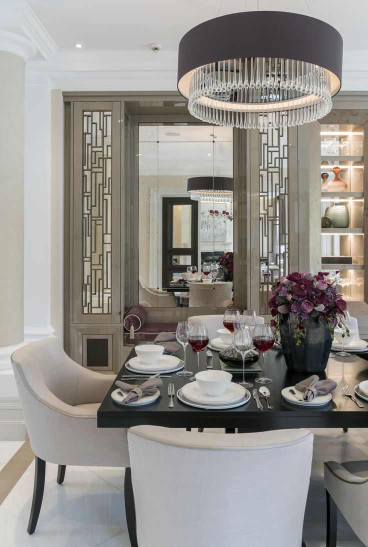 Crowning our Surrey dining room design with an elegant sense of harmony, this beautiful satin and crystal @HeathfieldAndCo Roehampton ceiling light pendant sits atop the luxurious table arrangement with bespoke chairs in @romoblack Milani Platinum fabric.